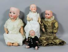 An early 20th Century Simon and Halbig No. 1294 bisque headed doll with open blue eyes, open mouth with two teeth, and with composition body, 18ins high, and three others, various