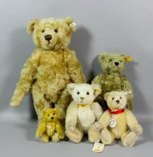 A late 20th Century Steiff plush mohair teddy bear with hump and button eyes, 18ins, and four other Steiff bears, various