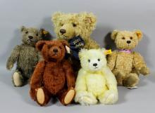 A modern Steiff blonde mohair teddy bear, 19ins, and four other Steiff teddy bears, various