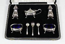 An Elizabeth II silver five piece condiment set,