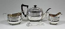 A George III silver rectangular three piece tea