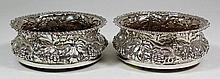 A pair of Edward VII silver circular coasters with