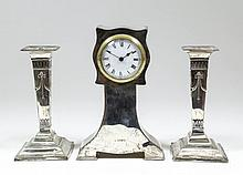 A George V silver cased mantel timepiece in the
