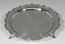 A George VI silver circular salver with shaped rim