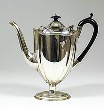 A late Victorian silver coffee pot of panelled