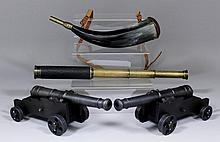 A pair of scale model bronzed iron field canon,