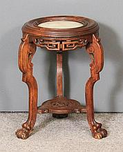 A Chinese stained wood circular stand, the moulded