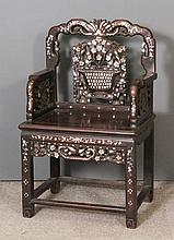 A Chinese rosewood armchair inlaid throughout in