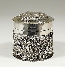 A late Victorian silver cylindrical box and cover