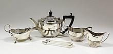 A George V silver bachelor's three piece tea