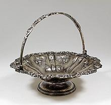 A Victorian silver circular basket of shaped