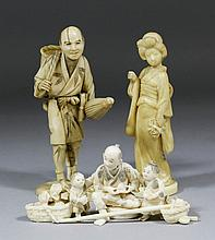 Three Japanese carved ivory figures - Man carrying