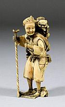 A Japanese small carved ivory standing figure of a
