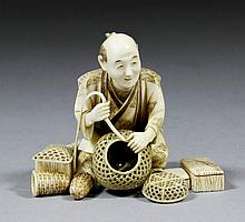 A fine Japanese carved ivory figure of a basket