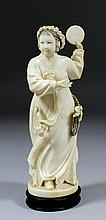 A Chinese carved ivory figure of a standing female