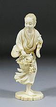 A good Japanese carved ivory standing figure of a
