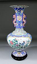 A Chinese Canton enamel bulbous two-handled vase