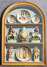 """ARR Frederick Clifford Harrison (1901-1984) - Oil painting - Trompe L'oeil - """"Plates, Figures and Vase"""" - An arched niche displaying Delft and Staffordshire pottery, arched top board 41ins x 28ins, initialled """"CH"""" and dated 1979, with plain whitewood"""