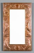 A late 19th/early 20th Century Newlyn rectangular copper wall mirror, the frame embossed with fish, shells and seaweed, and with bevelled mirror plate, 27.25ins x 16ins (stamped