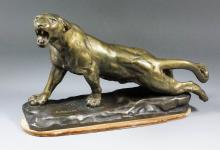 Jules Edmond Masson (1871-1932) - Gilt and green patinated bronze figure of a jaguar with open jaw poised to spring, on rectangular rocky base, 10ins x 19ins overall, with velour covered plinth
