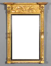 An early 19th Century English rectangular pier glass with moulded cornice, leaf scroll frieze and split turned columns to sides, with plain mirror plate, 35ins x 25.5ins overall