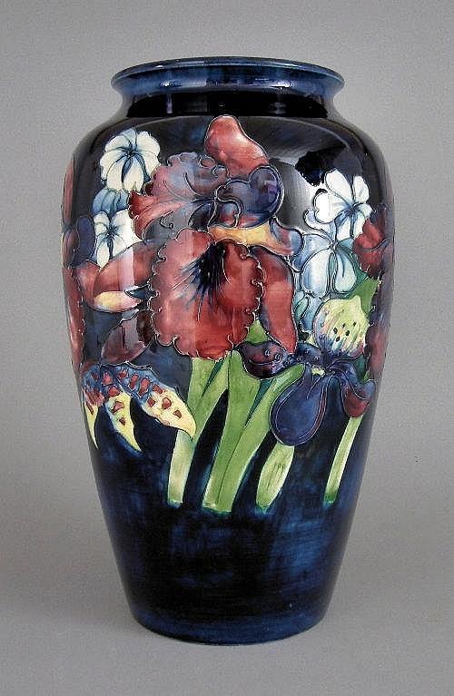 A Moorcroft pottery baluster shaped vase, tube