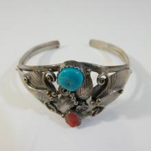 STERLING SILVER NAVAJO BRACELET WITH TURQUOISE AND CORAL