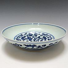A BLUE AND WHITE FLOWER DISH, QIANLONG