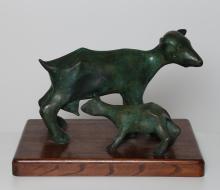 MC CORD   Scultura in bronzo con base in palissandro.  Firma alla base Mc Cord 1/9. -. Cm 57,00 x 38,00 x 39,50.
