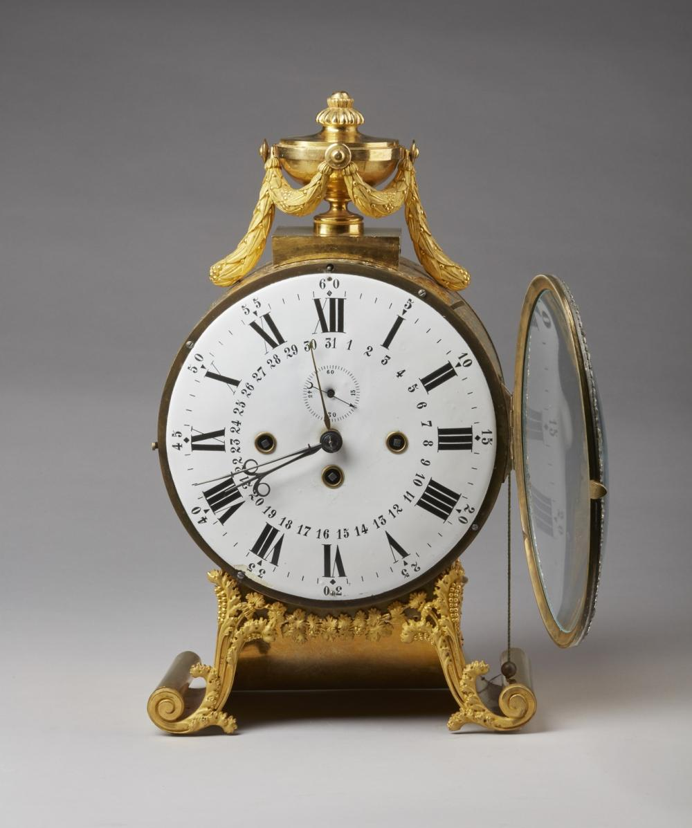 AUSTRIAN 19TH CENTURY A gilt bronze mantel clock with after the antique and phytomorphic decorations, on scrolled feet.