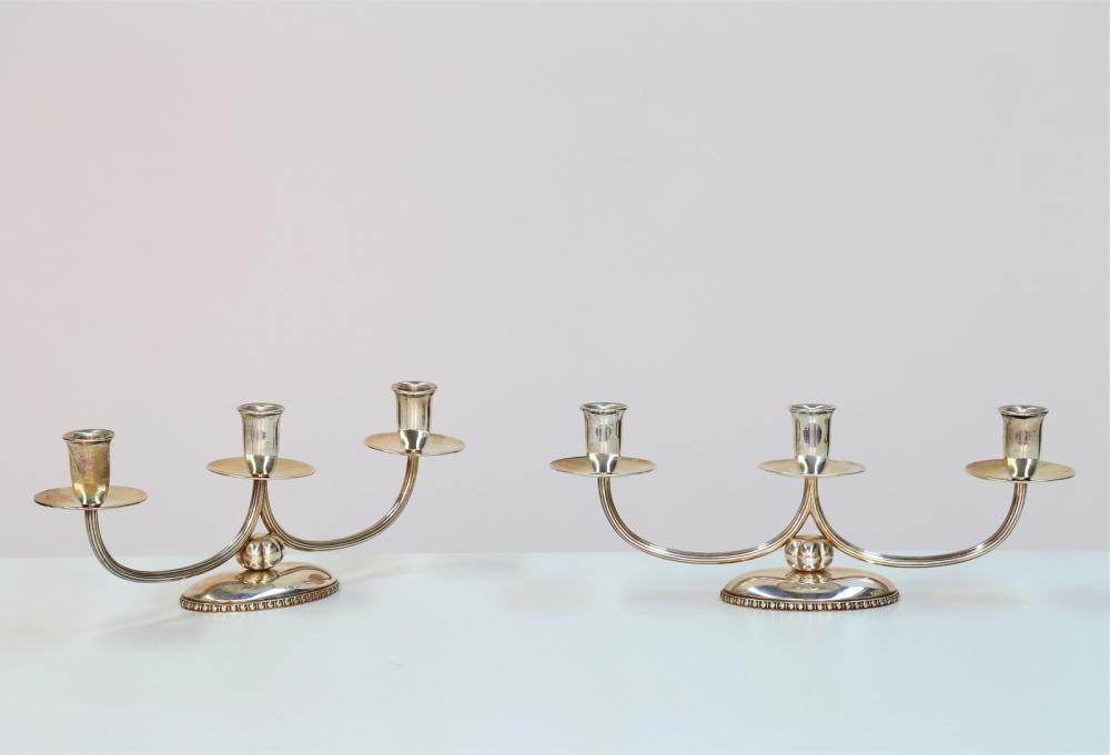ITALIAN MANUFACTURE Couple of candelabra with three flames