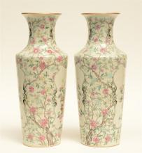 A fine pair of Chinese famille rose vases decorated with flower branches, f