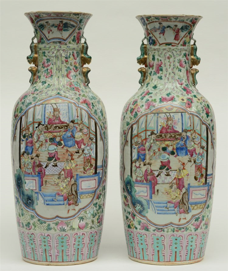 An exceptional pair of Chinese famille rose vases decorated with a court sc