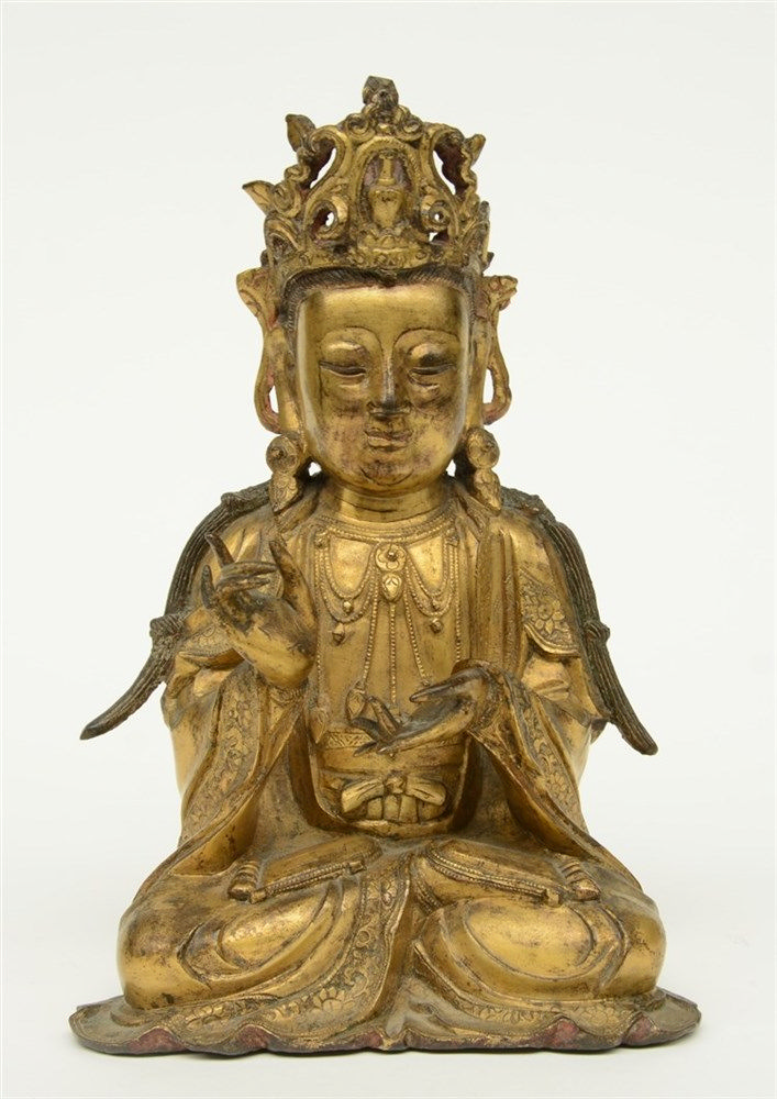 A Chinese gilt bronze Buddha, Ming, H 27,5 cm (traces of polychromy)