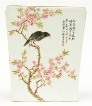 A Chinese famille rose plaque, representing a bird on a flower branch, sign