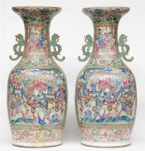 A large pair of Chinese famille rose vases decorated with court scenes, 19t