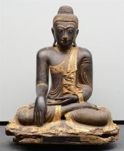 A rare Oriental gilt and polychrome decorated wooden Buddha, inlaid with ro