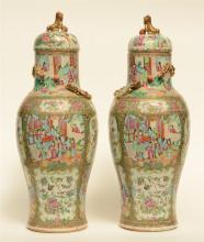 A pair of Chinese Canton vases with relief decoration in the shape of drago