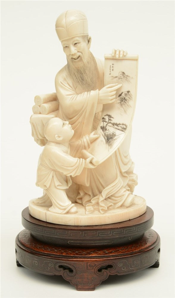 A late Qing dynasty ivory sculpture depicting a sage and his young pupil, r