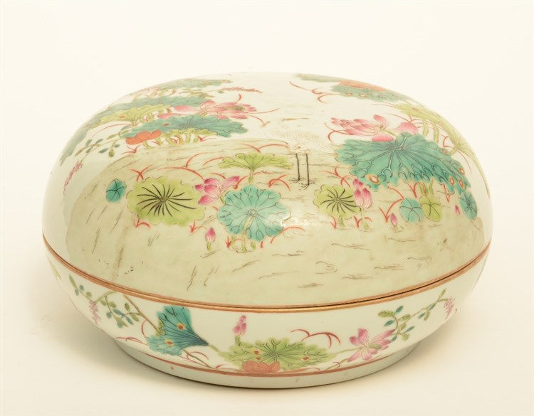 A Chinese famille rose bowl with cover, decorated with birds in a landscape