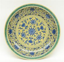 A Chinese large yellow ground and green dish with a blue and white floral d