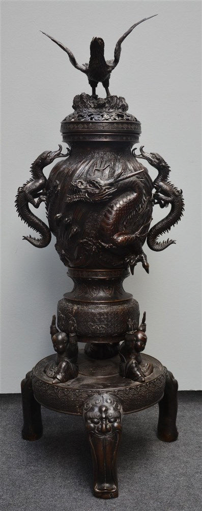 An impressive Japanese bronze incense burner with dragon relief decoration,