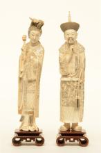 A pair of Chinese ivory dignitaries, on wooden base, late 19thC, H 37,5 - 3