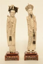 A pair of Chinese ivory figures of the imperial couple, on a fixed wooden b