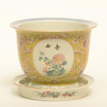 A Chinese famille rose and floral decorated cachepot in yellow background w