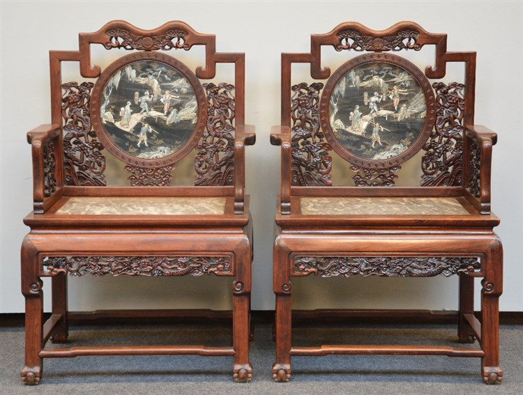 An exceptional pair of Chinese hardwood armchairs with relief decorations o