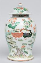 A Chinese famille verte vase with cover, decorated all around with ducks in