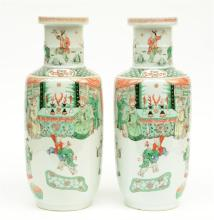 A fine pair of Chinese rouleau shaped vases, famille verte overall decorate