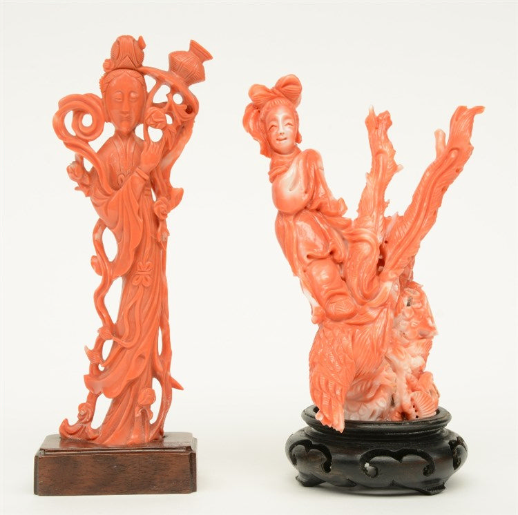 Two Chinese red coral sculptures depicting a court lady on a wooden base, H