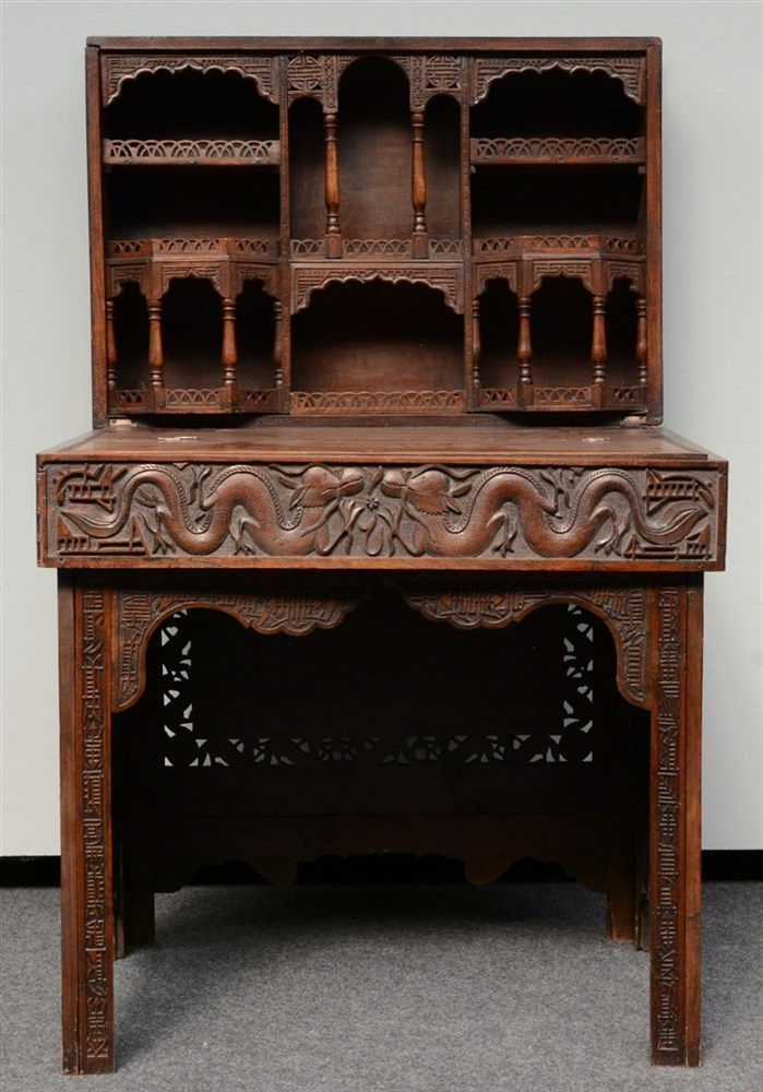 A Chinese carved hardwood travelling desk, relief decorated with dragons an
